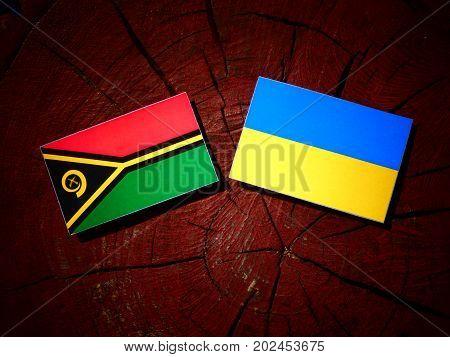 Vanuatu Flag With Ukrainian Flag On A Tree Stump Isolated