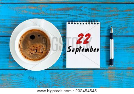 September 22nd. Day 22 of month, loose-leaf calendar on coffee cup at Programmer Analyst workplace background. Autumn time. Empty space for text.