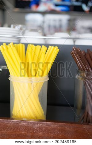Drinking yellow straws used for drinking water or soft drinks