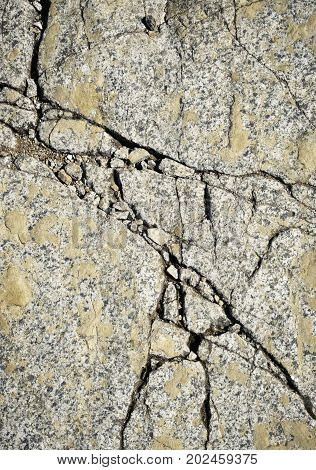 nature background or texture fissured surface of granite rocks