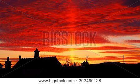 Red sky over Forfar. Forfar, Scotland - April 24, 2016 Phenomenal sky landscape over the Scottish town of Forfar.