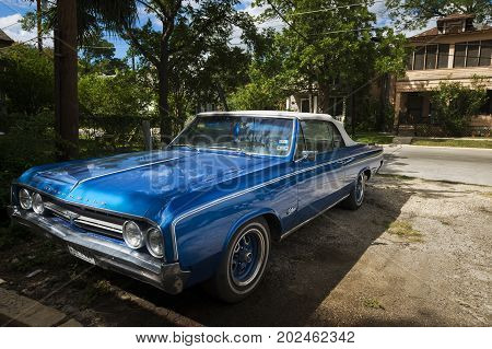 San Antonio Texas - June 5 2014: Classic blue car parked in a suburban area of the city of San Antonio Texas USA.