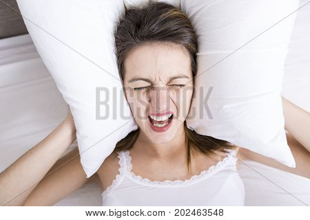 A Young sleeping woman in bedroom at home wearing in white
