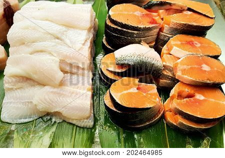 group of fresh fillet of fish ready to grilled