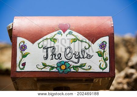 Old wooden mailbox with floral decoration painting