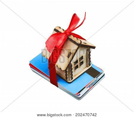 small house with ribbon on bunch of plastic credit debit cards on white background isolated