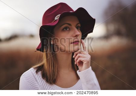 A Woman with long hair, fedora hat