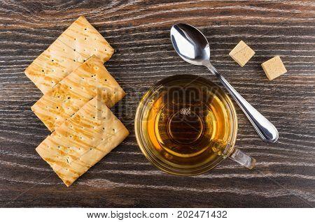 Cookies, Cup Of Tea, Lumpy Sugar And Teaspoon On Table