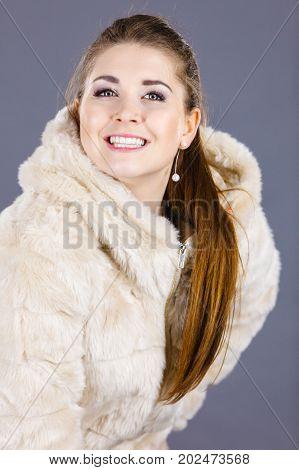 Happy Attractive Woman Wearing Furry Coat