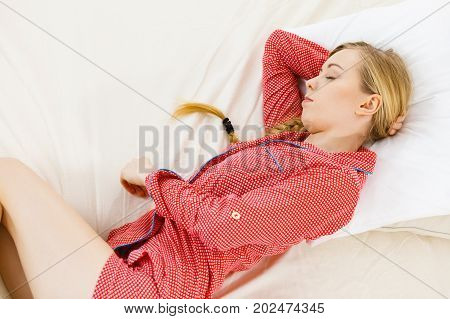 Woman Sleeping In Bed On The Side