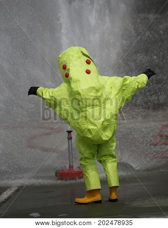 Person With Protective Suit With Air Filtering System To Breathe