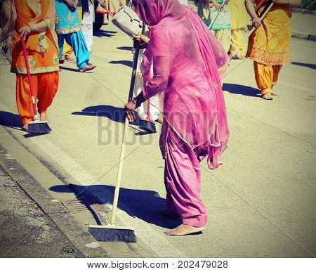 Sikh Religion Women During The Ceremony  While Sweeping The Stre