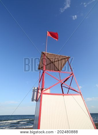Turret Of Lifeguard On The Beach With The Red Flag