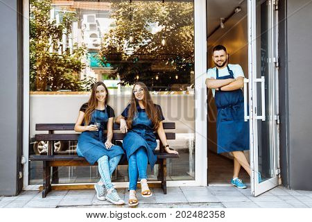 A Team Of Young Barists Near A Cafe