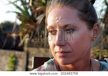 Portrait of a woman with rice on her forehead. Rice on the forehead after the end of prayer is a symbol of longevity prosperity and closeness to God