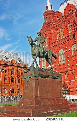 Moscow Russia - 14 July 2017: Monument to Marshal Zhukov on the background of the Historical Museum. Sculptor Vyacheslav Klykov portrayed the Marshal at the time of receiving the parade in honor of Victory in the great Patriotic war held on red square on
