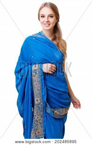 Caucasian blonde smiling girl in blue indian national dress sari in studio on white background isolated