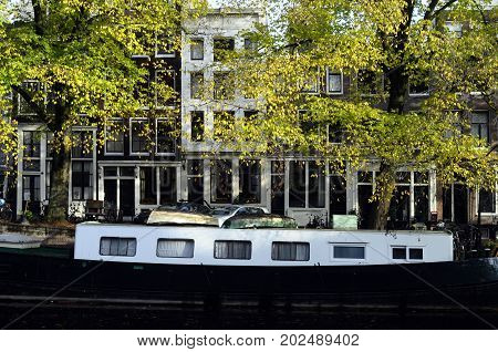 Houseboat And Architecture In Old City Of Amsterdam