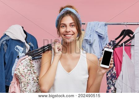 Retail, Sale, Consumerism And Modern Technology Concept. Portrait Of Charming Young Female Standing