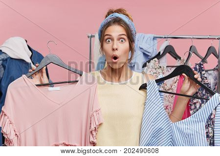 Omg, Wow. Excited Young European Female Shopaholic Searching For Clothes In Store, Shocked With Sale