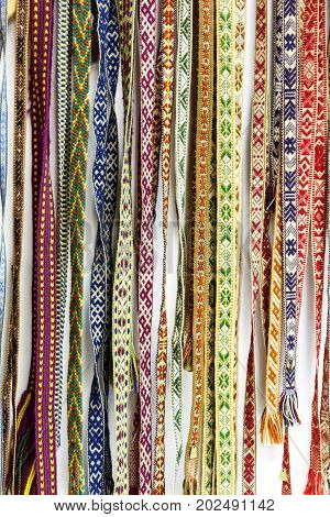 Traditional  Ethnographic Latvian Garter Wool Belts Background