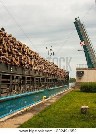 Barge with wood passes through a sluice in Finland.
