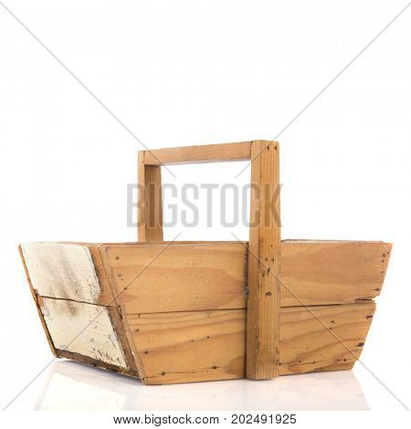 Empty wooden harvest basket isolated over white background