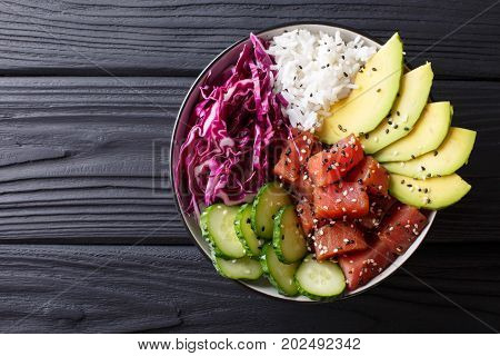 Raw Organic Ahi Tuna Poke Bowl With Rice And Veggies Close-up. Horizontal Top View