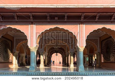 JAIPUR RAJASTHAN INDIA - MARCH 10 2016: Wide angle picture of indian style architecture inside of City Palace in Jaipur known as pink city of Rajasthan in India.