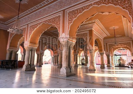 JAIPUR RAJASTHAN INDIA - MARCH 10 2016: Wide angle picture of ornated pillars with amazing architecture inside of City Palace in Jaipur known as pink city of Rajasthan in India.