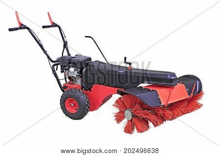 Red Sweeping Machine Isolated On White Background. Manual Sweeping Machine For Offices And Streets.