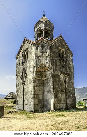 Three navesthe bell tower with the umbrella dome in the monastery of Gregory the Illuminator in Armenian village of Haghpat