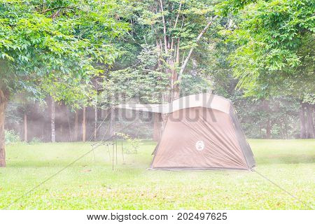 Family Tent In The Mist In Thailand