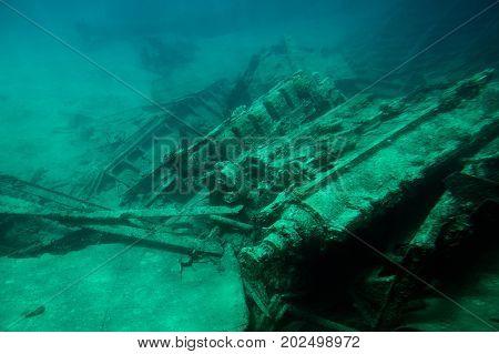 Shipwreck in Grand Cayman island on bottom of blue sea