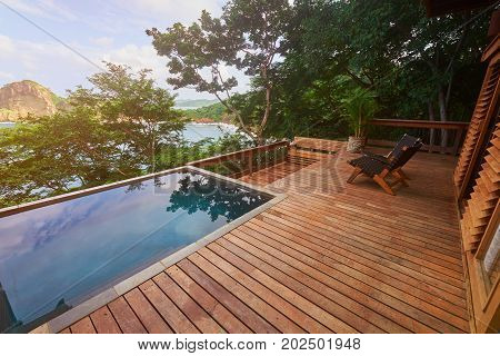 Luxury villa patio from wood. Luxury hotel theme