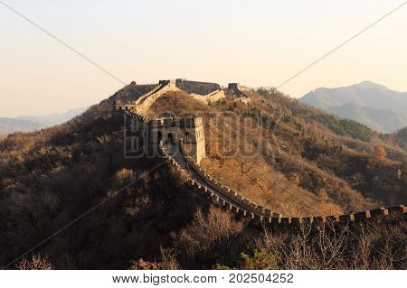 Tourist At The Great Wall Of China. The Great Wall Of China Is The World's Longest Wall And Biggest
