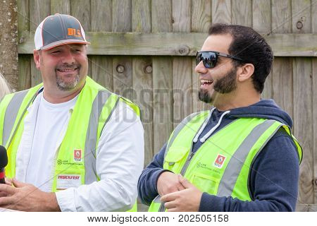 NORFOLK UK - AUGUST 19th 2017: Truckfest Norwich is a transport festival in the UK. Jesse Mcclure and Tod Dewey relaxing before showtime