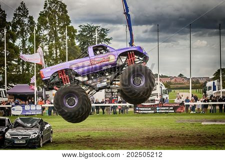 NORFOLK UK - AUGUST 19th 2017: Truckfest Norwich is a transport festival. Monster Truck big air jump over crushed cars