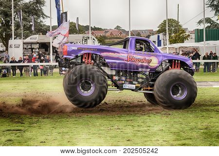 NORFOLK UK - AUGUST 19th 2017: Truckfest Norwich is a transport festival in the UK based around the haulage industry located in Norfolk. Including Monster Truck Slingshot driven by Alan Vaughan