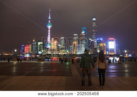 Shanghai China - November 29, 2016:  Couple At Pudong District Skyscrapers At Night In Shanghai Chin