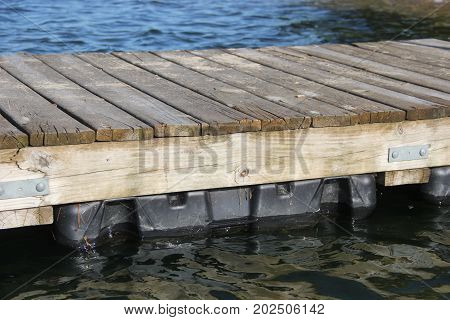 A wooden floating dock in a inland lake