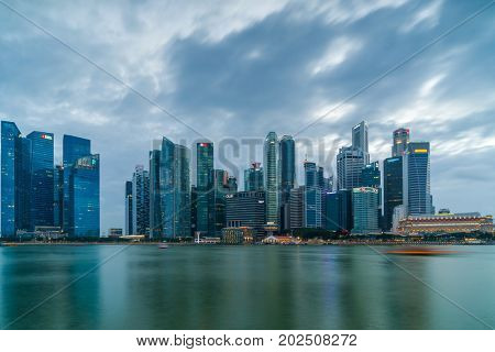 Singapore - February 12 2017: Singapore Cityscape Financial building with Dramatic Cloud in Marina Bay area Singapore at  Dusk.