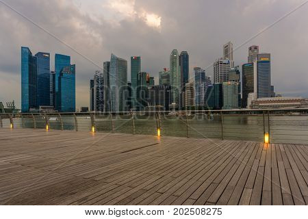 Singapore - February 09 2017: Singapore Cityscape Financial building with Dramatic Cloud in Marina Bay area Singapore at  Dusk