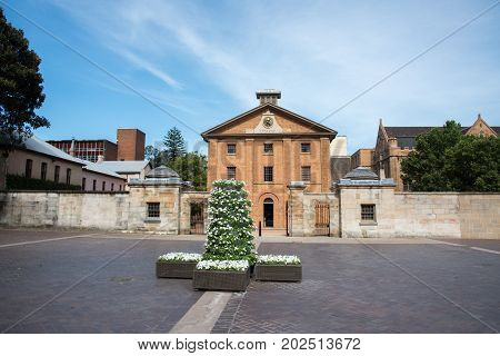 SYDNEY,NSW,AUSTRALIA-NOVEMBER 20,2016: Hyde Park Barracks Museum with spring planter in Sydney, Australia.