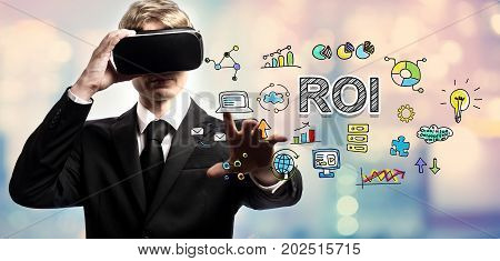 ROI text with businessman using a virtual reality headset