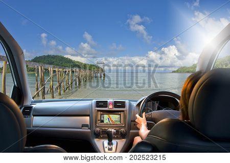 Woman travel by four wheel drive car on beach.
