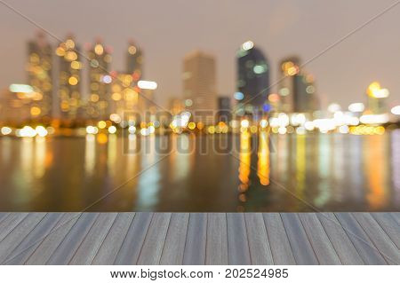Opening wooden floor Night blurred bokeh office building downtown abstract background