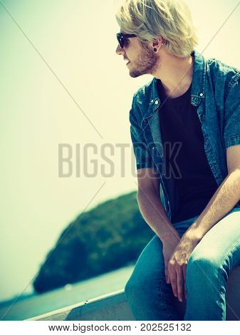 Sitting Man Relaxing, Enjoying Summertime