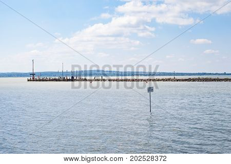 Scenic picture of Lake Balaton waterfront and a 120 m sign Hungary