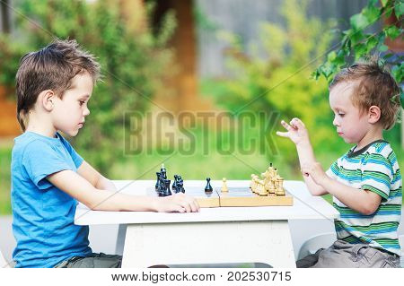 beginning of the game of chess. two young chess players outdoors